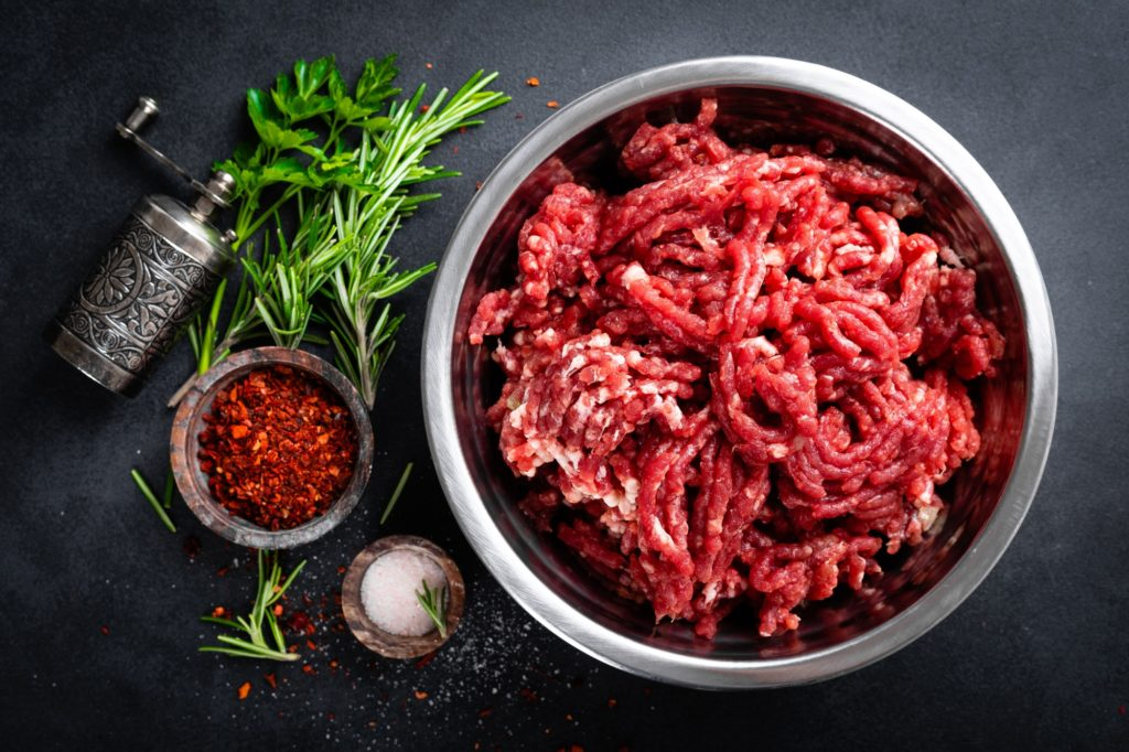 Mince. Ground meat with ingredients for cooking